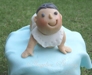 Detail of fondant icing baby